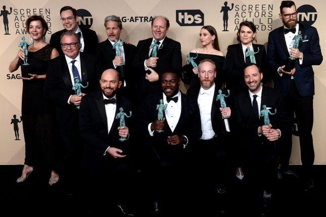Back row, from left to right, Margaret Colin, Kevin Dunn, Nelson Franklin, Gary Cole, Dan Bakkedahl, Sarah Sutherland, Clea DuVall, and Timothy Simons; front row, Paul Scheer, Sam Richardson, Matt Walsh, and Tony Hale appear backstage with the award for Outstanding Performance by an Ensemble in a Comedy Series for Veep, during the SAG Awards Sunday night. Photo by Jim Ruymen/UPI