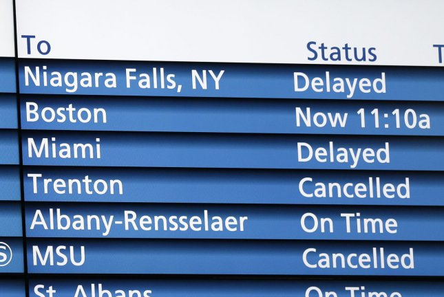 An Amtrak destination board is seen at Pennsylvania Station in New York City. Service on two trains between New York City and Miami began a reduced schedule Monday. File Photo by John Angelillo/UPI