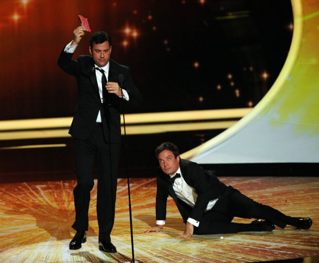TV show host's Jimmy Kimmel (L) and Jimmy Fallon peform on stage during the 63rd Annual Primetime Emmy Awards at the Nokia Theatre in Los Angeles on September 18, 2011. UPI/Jim Ruymen