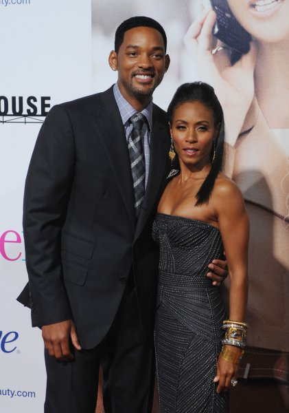 Actress Jada Pinkett Smith (R), who stars in the dramatic comedy motion picture The Women, and her husband, actor Will Smith attend the premiere of film, a remake of George Cukor's 1939 film in Los Angeles on September 4, 2008. (UPI Photo/Jim Ruymen)