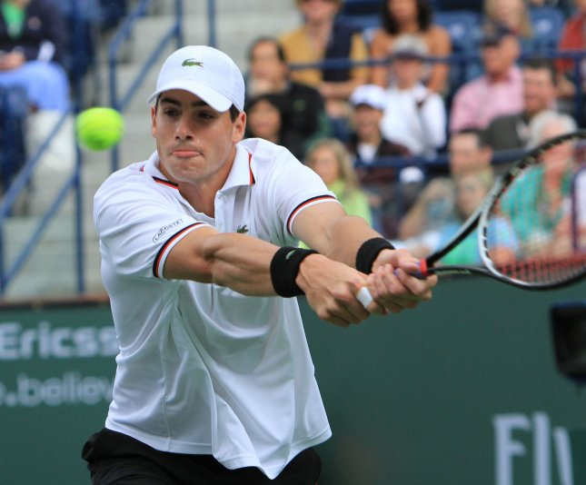 John Isner, shown playing in a match last month, defeated Gilles Simon in straight sets Friday and pulled the United States even with France at 1-1 in their best-of-five Davis Cup series. UPI/David Silpa