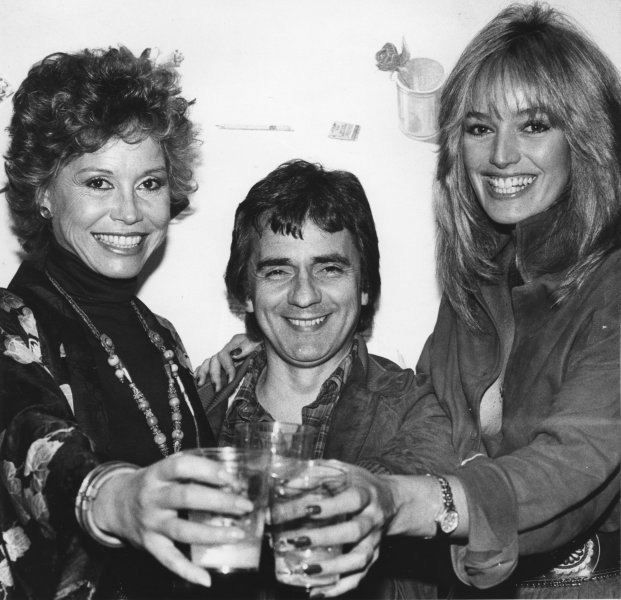 "It was a big week for Dudley Moore (C), He and co-star Mary Tyler Moore (L) joined in a toast with Dudley's date, Susan Anton (R), at last week's Wrap"" party marking the completion of their movie, ""Six Weeks."" Then came Saturday's presentation of the Hollywood Foreign Press Association's Golden Globe Awards. Moore won as best motion picture actor in a comedy, and his movie Arthur was named best motion picture comedy of the year. Best actor award went to Henry Fonda. (UPI Photo/Glenn Waggner/Files)"