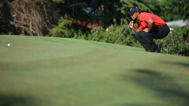 Tiger Woods lines up a putt on the 16th green during the fourth round of the AT&T National at Congressional Country Club on July 1, 2012 in Bethesda, Maryland. Woods went on to win the AT&T National with eight-under-par. UPI/Kevin Dietsch