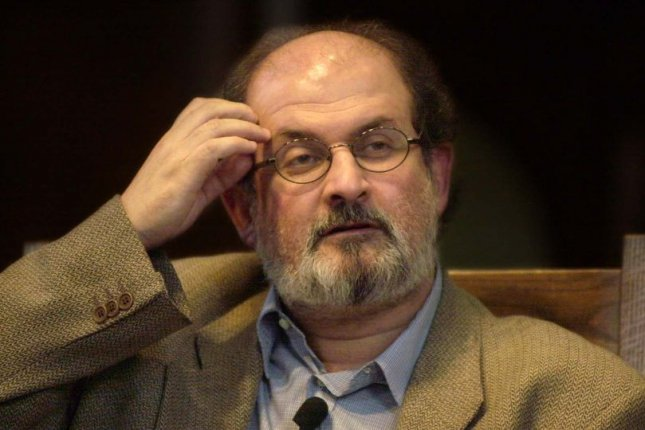 Indian-born novelist Salman Rushdie, best known for his controversial and critically acclaimed novel The Satanic Verses, addresses students at the Washington University Graham Chapel in Clayton, Mo., in 2002. Wednesday, Iranian media reported that an additional $600,000 has been raised to add to a bounty ordering Rushdie's death -- an order which stems from the novel. File photo by rlw/bg/Xenia Naert/UPI