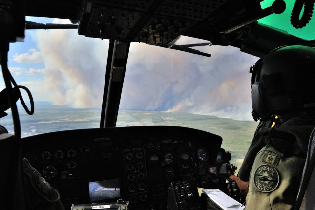 Though wildfires continue to burn out of control, provincial authorities have cleared the re-entry to oil areas in Canada as threat moves east and away from Alberta. Photo by MCpl VanPutten/Canadian Armed Forces/UPI
