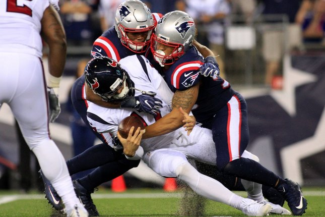 Houston Texans quarterback Brock Osweiler (17) is sacked by New England Patriots defensive lineman Jabaal Sheard (93) and Trey Flowers (98) in September. He's about to be sacked again by the Cleveland Browns. Matthew Healey/ UPI