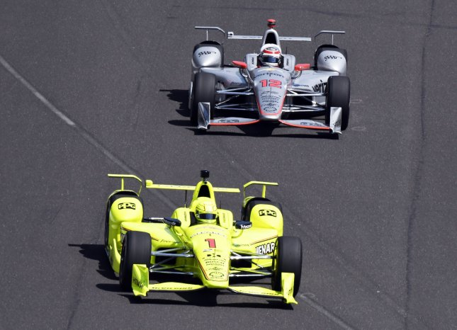 Simon Pagenaud (1) leads teammate Will Power out of the pits during the final practice for the Indy 500 at the Indianapolis Motor Speedway in May. Photo by Larry Papke/UPI