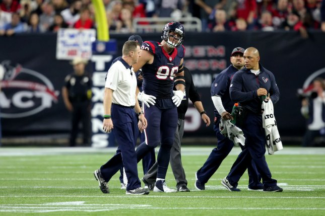 Houston Texans defensive end J.J. Watt (99) is helped off the field after sustaining a groin injury in the third quarter of the Texans-Chiefs NFL Wild Card Round game at NRG Stadium in Houston, TX on January 9, 2016 in Houston. File photo by Erik Williams/UPI