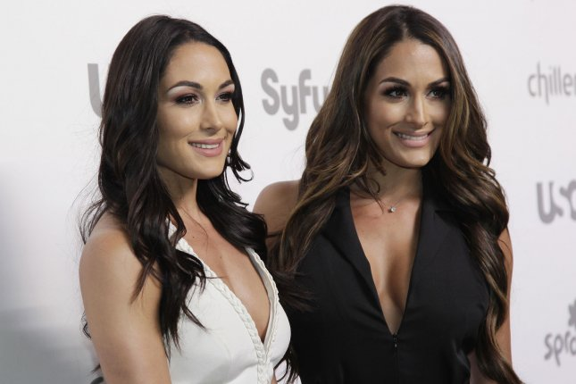 Brie Bella (L) said that she will be Nikki Bella's maid-of-honor at her upcoming wedding. File Photo by John Angelillo/UPI