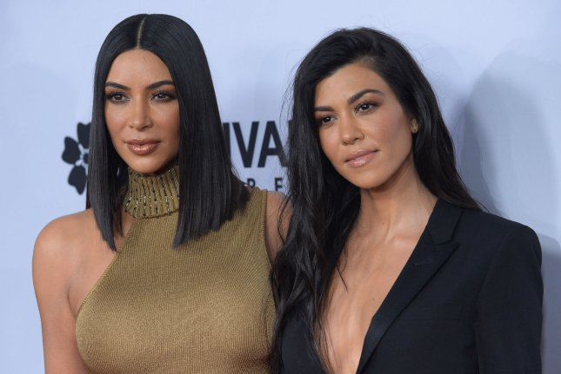 Kourtney Kardashian (R) and Kim Kardashian posted tributes to late dad Robert Kardashian on his birthday. File Photo by Jim Ruymen/UPI