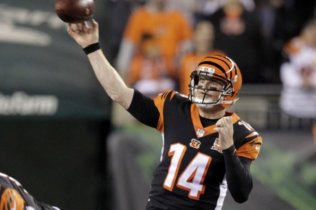 Cincinnati Bengals quarterback Andy Dalton (14) throws under pressure from  the Pittsburgh Steelers  defense during the first half of play on December  4 509223cd2