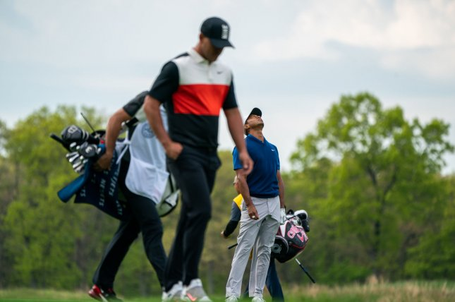 Brooks Koepka (C) cruised to a victory at the 2019 PGA Championship, while betting favorite Tiger Woods (R) missed the cut for Saturday's third round at the Bethpage Black Course in Old Bethpage, N.Y.  Photo by Corey Sipkin/UPI