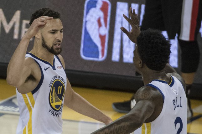 Golden State Warriors guard Klay Thompson (L) agreed to a five-year, $190 million max contract extension. Photo by Terry Schmitt/UPI