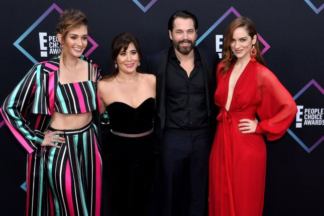 Melanie Scrofano (R), pictured with Katherine Barrell, Emily Andras and Tim Rozon (left to right), plays the title character in the Syfy series Wynonna Earp. File Photo by Jim Ruymen/UPI