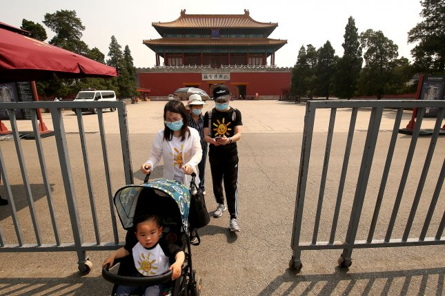A few Chinese visit a normally bustling, but just recently opened, Forbidden City after the government lowered the coronavirus threat to level two in Beijing on Saturday. Despite the small numbers of visitors, the landmark was open only to Chinese who had a proper pass or reservation. Photo by Stephen Shaver/UPI
