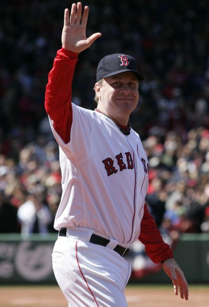 Boston Red Sox pitcher Curt Schilling waves to the crowd at Fenway Park as he walks out to receive his 2007 World Series ring in a ceremony before the Red Sox home opener against the Detroit Tigers Boston, Massachusetts on April 8, 2008. (UPI Photo/Matthew Healey)