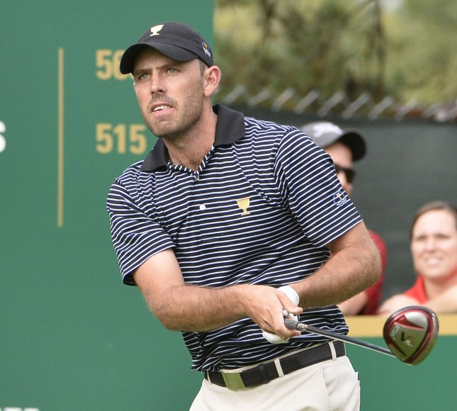 International Team member Charl Schwartzel of South Africa tees off on the seventh hole during the second round foursome competition against the United States Team at the 2013 Presidents Cup at Muirfield Village Golf Club in Dublin, Ohio on October 4, 2013. UPI/Brian Kersey