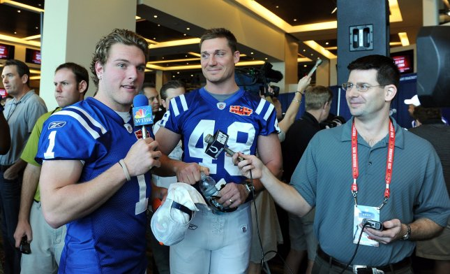 Indianapolis Colts punter Pat McAfee (L) interviews tight end Justin Snow in jest for a local television station on Media Day at Sun Life Stadium in Miami on February 2, 2010. Super Bowl XLIV will feature the Indianapolis Colts and New Orleans Saints on Sunday, February 7. UPI/Roger L. Wollenberg