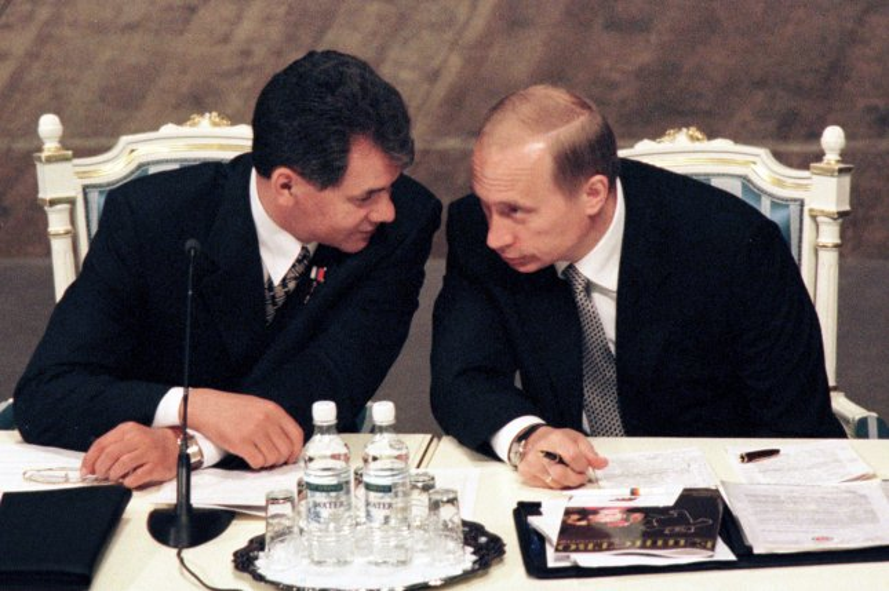 Russian Defense minister Sergei Shoigu, left, speaking with Russian President Vladimir Putin. UPI/Maxim Marmur