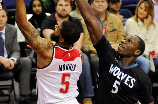 Washington Wizards forward Markieff Morris (5) goes to the basket and is fouled by Minnesota Timberwolves center Gorgui Dieng (5) in the first half at the Verizon Center in Washington, D.C. on March 25, 2016. Photo by Mark Goldman/UPI
