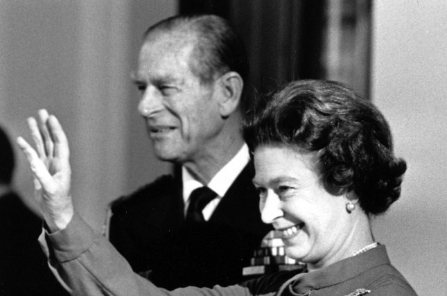 Queen Elizabeth II, pictured here with Prince Philip in 1984, waves goodbye to French President Francois Mitterrand at Buckingham Palace as the president leaves for Paris following his four-day state visit to England. This weekend, Britain will celebrate the Duke of Edinburgh's 95th birthday with a slate of events that will also commemorate the queen's 90th birthday from April. UPI File Photo