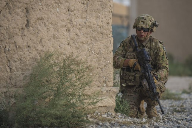 U.S. Army Spc. David Cruz, 717th Explosive Ordinance Disposal Unit, guards the perimeter during a mass casualty and extraction exercise with Airmen from the 83rd Expeditionary Rescue Squadron, Bagram Airfield, Afghanistan, August 18. During his campaign, President Donald Trump said he wanted the United States to get out of Afghanistan, but he's said little about the country since then. File Photo by Justyn M. Freeman/U.S. Air Force/UPI