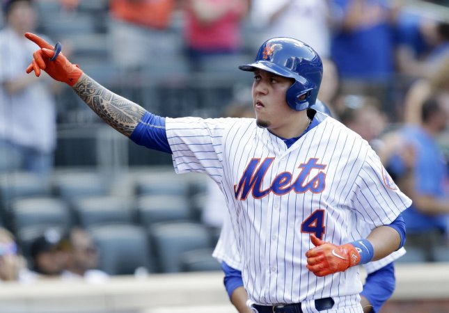 Wilmer Flores and the New York Mets overtook the Oakland A's on Saturday. Photo by John Angelillo/UPI