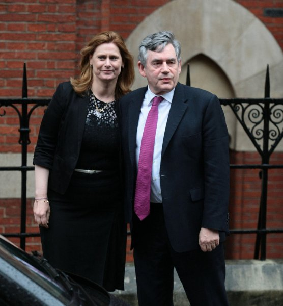 Former British Prime Minister Gordon Brown leaves the Royal Courts of Justice with his wife Sarah after being interviewed at the Leveson Inquiry in London on June 11, 2012. This month, Brown is publishing his memoir, in which he accuses the U.S. government of lying about its knowledge of Iraq having WMD's in 2003. File photo by Hugo Philpott/UPI