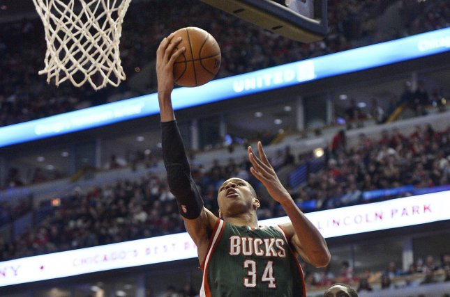 Milwaukee Bucks forward Giannis Antetokounmpo (L) drives past Chicago Bulls forward Tony Snell on his way to a score during the third quarter of game 5 the first round of the NBA Playoffs at the United Center on April 27, 2015 in Chicago. File photo by Brian Kersey/UPI