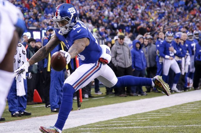 d476b02e5 New York Giants receiver Odell Beckham Jr. reaches the football over the  goal line for a four-yard touchdown reception in the second half against the  ...