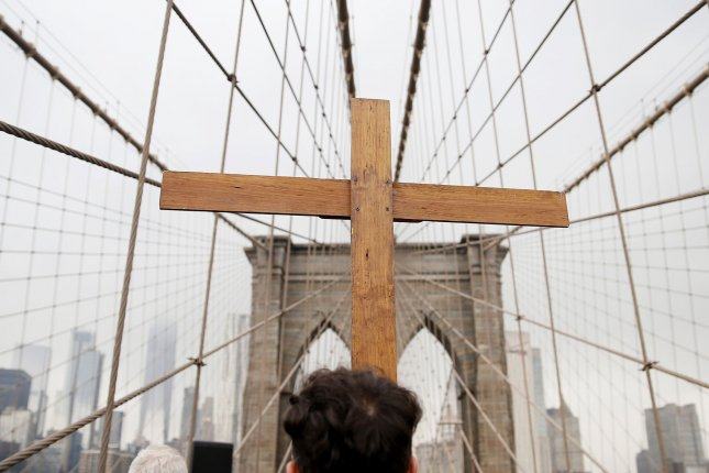 A wooden Catholic cross is seen during an event on the Brooklyn Bridge in New York City. A leading advocate for victims said Thursday the new filing is an attempt by a Long Island diocese to conceal the truth about predator priests. File Photo by John Angelillo/UPI