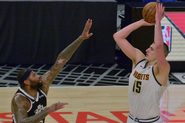 Denver Nuggets center Nikola Jokic (R), shown May 1, 2021, becomes the sixth international player to win the NBA's Most Valuable Player award. File Photo by Jim Ruymen/UPI