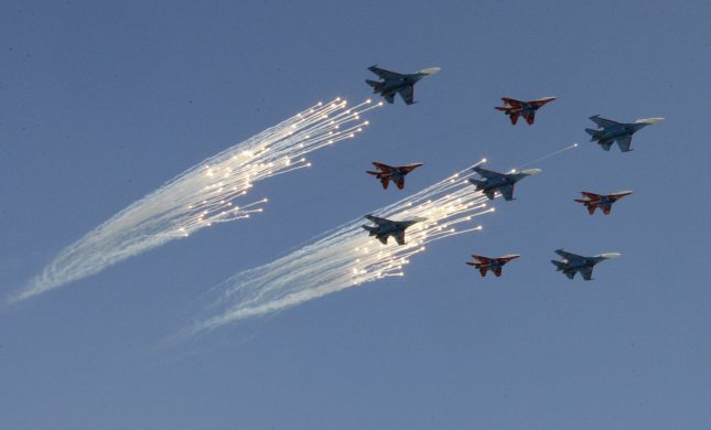 Russian fighter jets fly during the Victory Day military parade in Red Square in Moscow on May 9, 2009. Today Russia celebrates the 64th anniversary of the World War Two victory over Nazi Germany. UPI/Anatoli Zhdanov