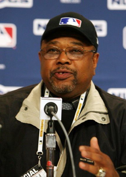 Bob Watson, Vice President of On-Field Operations for Major League Baseball, announces to reporters the cancellation of Game 5 of the National League Championship between the New York Mets and the St. Louis Cardinals due to the weather on October 16, 2006. (UPI Photo/Bill Greenblatt)