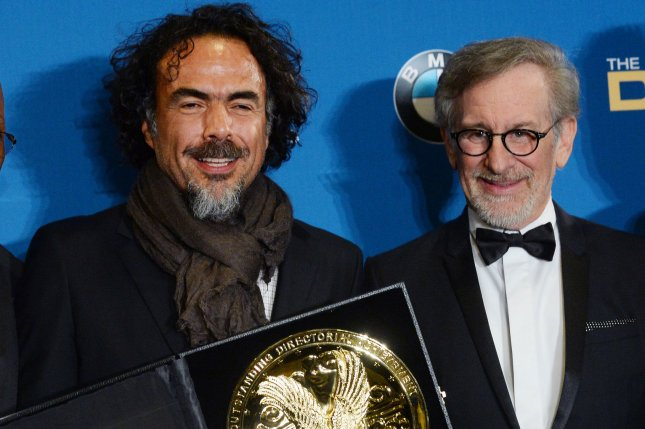 Birdman writer-director Alejandro Inarritu (L) mingles with director Steven Spielberg as he appears backstage with the prize for outstanding directional achievement for a feature film, giving Inarritu and possibly Birdman or (The Unexpected Value of Ignorance) an edge ahead of the Academy Awards during the 67th annual Directors Guild of America Awards at the Hyatt Regency Century Plaza in Los Angeles on February 7, 2015. Photo by Jim Ruymen/UPI
