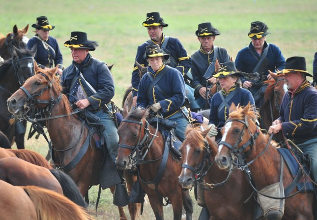 A Union cavalry unit prepares to charge during a re-enactment of the Civil War Battle of Bull Run at Brawner Farm in Manassas, Va., July 24, 2011. This event marked the 150th anniversary of the first major battle of the war, which officially ended on June 2, 1865.. File Photo by Kevin Dietsch/UPI