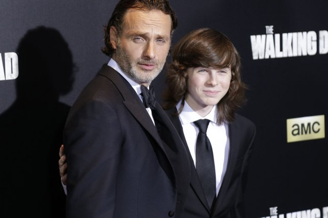 Andrew Lincoln and Chandler Riggs arrive on the red carpet at AMC's The Walking Dead Season 6 fan premiere event in New York City on October 9, 2015. File photo by John Angelillo/UPI