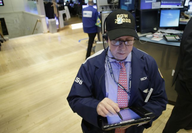 A trader on the floor of the NYSE wears a DOW 22,000 hat after the opening bell at the New York Stock Exchange on Wall Street in New York City on Wednesday. Photo by John Angelillo/UPI