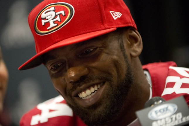 Randy Moss speaks to reporters as a member of the San Francisco 49ers prior to Super Bowl XLVII in 2013. Photo by Kevin Dietsch/UPI