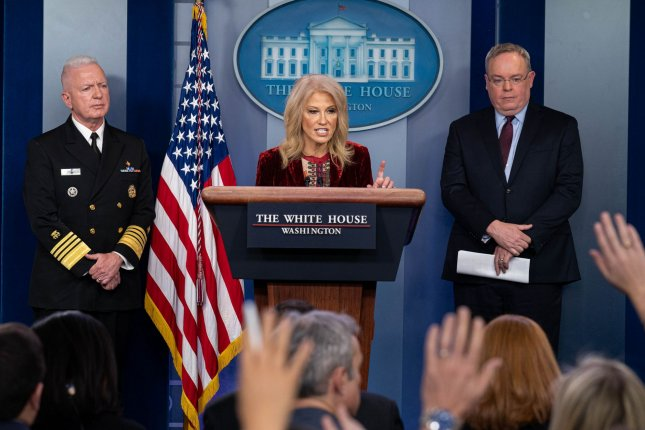 White House counselor Kellyanne Conway speaks with reporters at the White House Thursday about declines in opioid-related overdoses in the United States, with Office of National Drug Control Policy Director Jim Carroll (R) and Assistant Public Health Administration Secretary Brett Giroir. Photo by Ken Cedeno/UPI