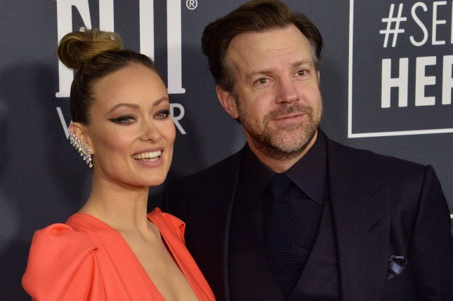 Jason Sudeikis (R) and Olivia Wilde attend the 25th annual Critics' Choice Awards on January 12. Sudeikis' comedy series Ted Lasso has been renewed for a third season. File Photo by Jim Ruymen/UPI