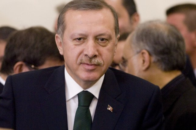 Turkish Prime Minister Recep Tayyip Erdogan is seen as Iran, Turkey and Brazil sign an agreement to ship Iran's low-enriched uranium to Turkey in exchange for fuel for a nuclear reactor in Tehran, Iran, on May 17, 2010. Iran signed an agreement to swap its uranium in Turkey for enrichment, hoping to avert new international sanctions. Brazil helped broker the deal. UPI/Maryam Rahmanian