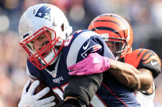 New England Patriots tight end Rob Gronkowski (87) is dragged down by Cincinnati Bengals cornerback Josh Shaw (26) on a 38-yard reception in the third quarter at Gillette Stadium in Foxborough, Massachusetts on October 16, 2016. The Patriots defeated the Bengals 35-17. Photo by Matthew Healey/ UPI