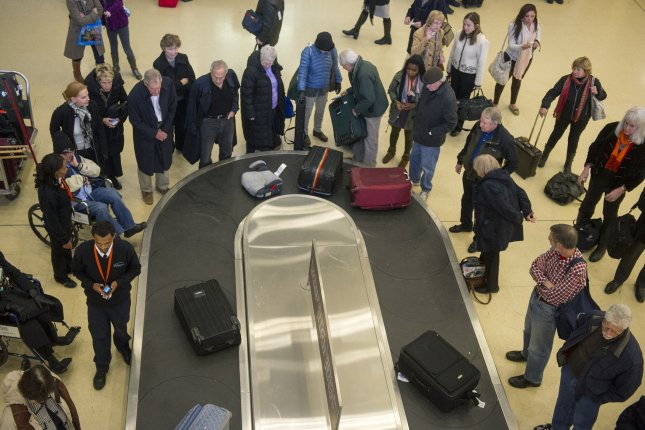 A federal appeals court judge ruled Friday a California woman has the right to sue as part of a class action after US Airlines refused to refund her $15 luggage fee when they lost her bag. The case could cost American Airlines, which took over US Air, millions depending on the outcome of the case. File photo by Kevin Dietsch/UPI