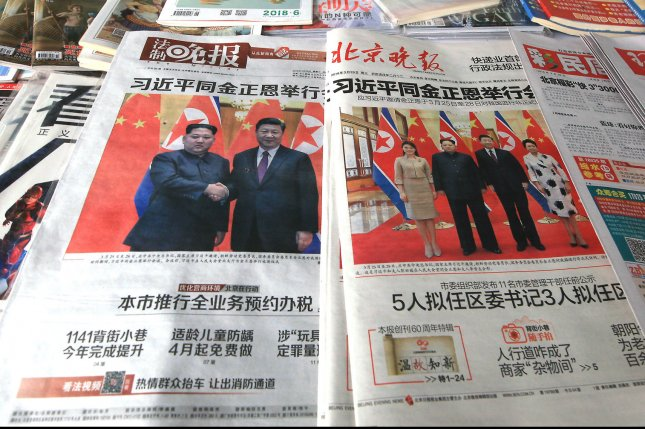 Several of China's top state-controlled newspapers featured a front page story about Chinese President Xi Jinping meeting with North Korean leader Kim Jong Un last week.Photo by Stephen Shaver/UPI