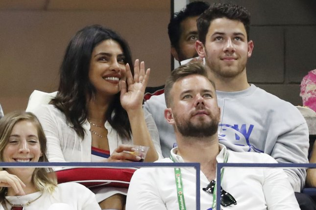 Nick Jonas (R) and his wife Priyanka Chopra. Jonas posted a wedding photo featuring his brothers Joe, Kevin and Frankie Jonas. File Photo by John Angelillo/UPI