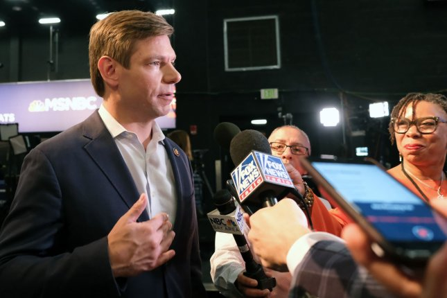 Rep. Eric Swalwell talks to the media in the spin room prior to the Democratic presidential primary debate in the Adrienne Arsht Center for the Performing Arts in Miami. On Monday, he's expected to withdraw from the race. Photo by Gary I Rothstein/UPI