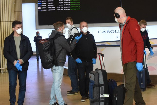 Travelers wears masks and gloves for protection against the coronavirus after arriving at Ben Gurion Airport in Lod, Israel, on Wednesday. Photo by Debbie Hill/UPI