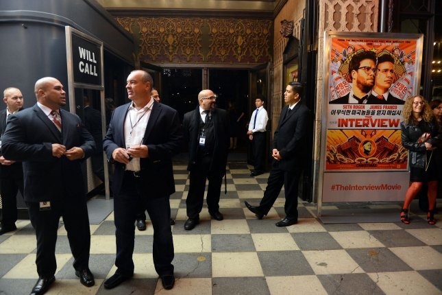 Heavy security is seen outside The Theatre at Ace Hotel before the premiere of the motion picture comedy The Interview in Los Angeles in 2014. The film, which mocked North Korean leader Kim Jong Un, may have been the motive for the 2014 hacking of Sony Pictures. File Photo by Jim Ruymen/UPI