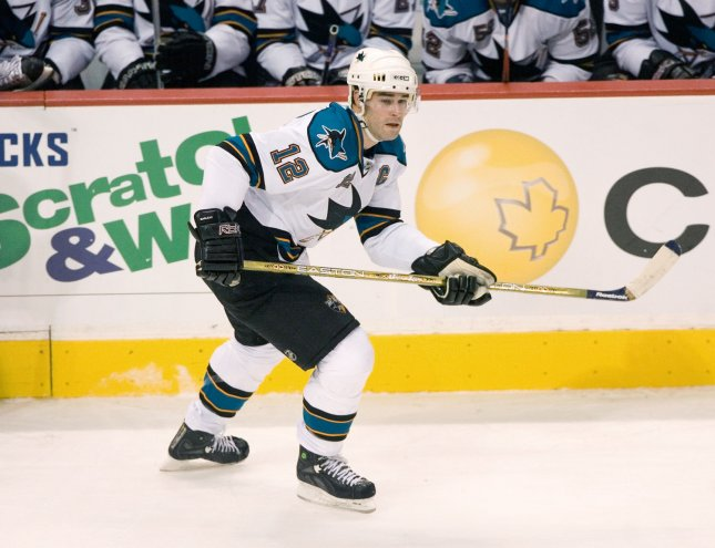San Jose Sharks' Patrick Marleau wrote his name in the record books at 9:30 of the first period, scoring on a power play as the San Jose Sharks defeated the Vancouver Canucks 4-1. File Photo by Heinz Ruckemann/UPI